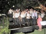 Christmas Carols in the rain at a packed Government House on Monday evening